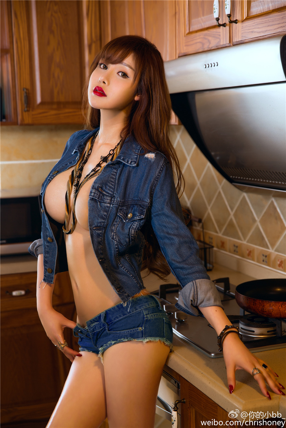 hot attractive Chinese beautiful girl standing in bewitching posture